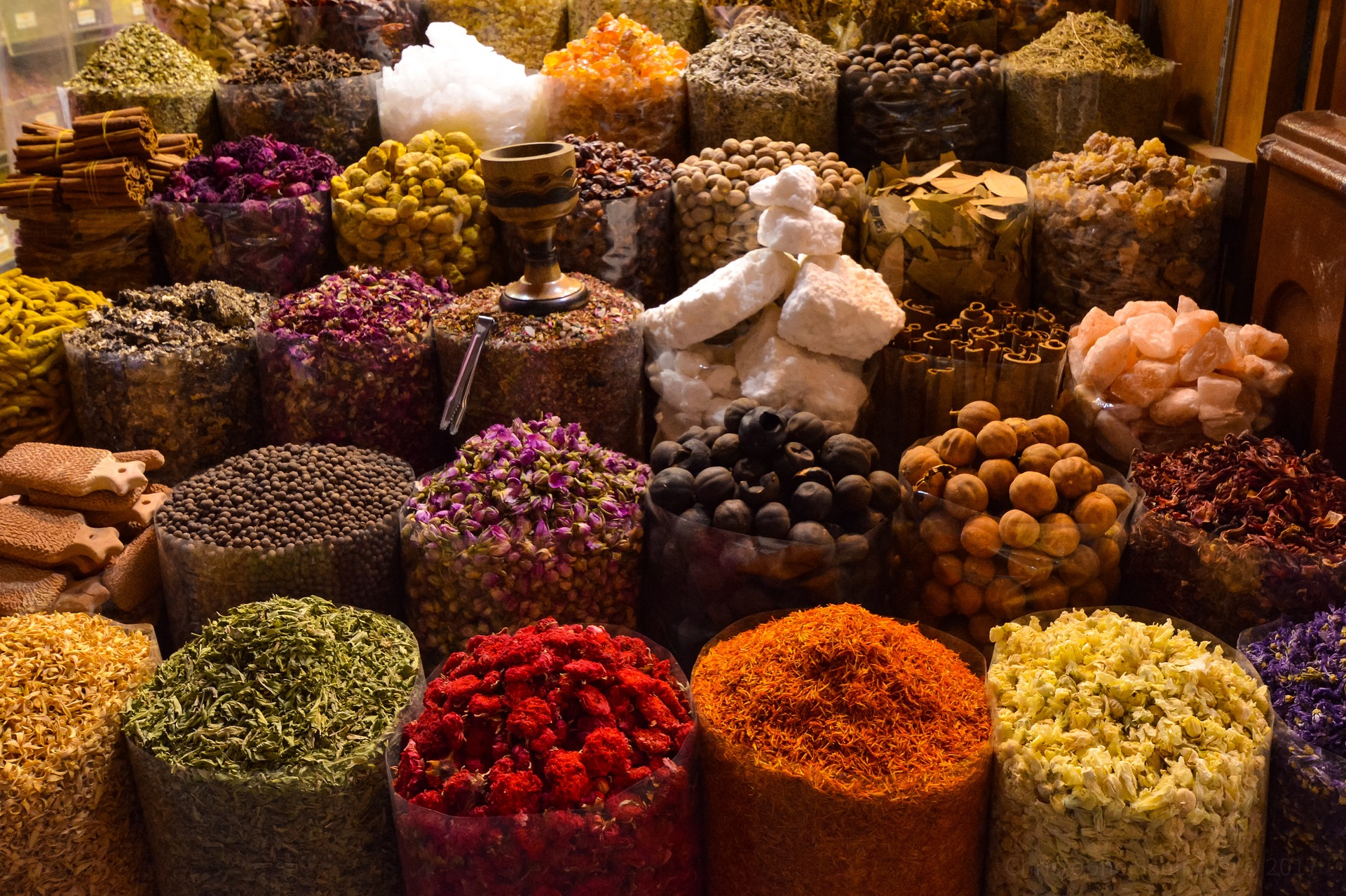 An array of colourful spices and herbs.